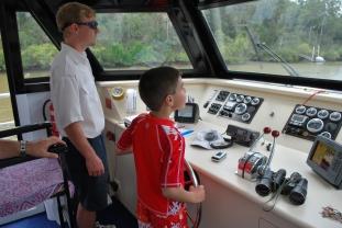 11-28-09 Aidan steers boat