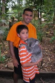 11-28-09 Neerav & Nathan cuddling koala
