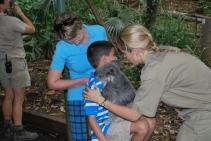 11-28-09 Shellie & Aidan placing koala