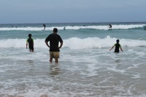 12-5-09 Boys watch surfers