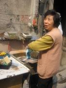3-27 Woman washing clothes