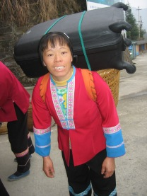3-29 Female sherpa with 60-lb suitcase