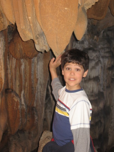 3-29 Nathan touches stalagtite