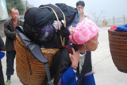 3-29 Older woman loaded down