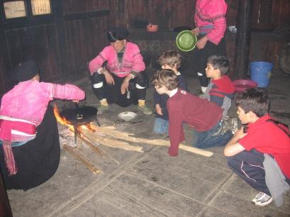 3-30 Boys watch Yao women prepare food
