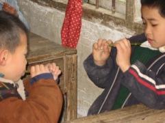 3-31 Boys inspect flutes