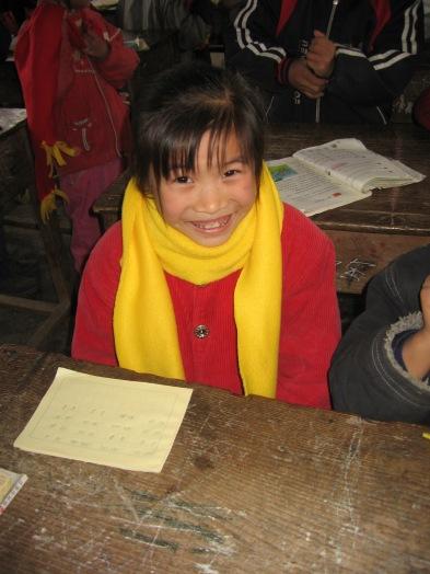 3-31 Girl smiling, yellow scarf