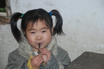 3-31 Pigtailed girl plays flute