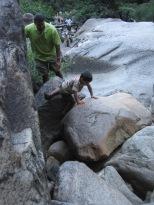 7-29 Aidan climbing boulders