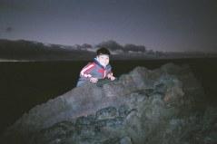 12-20-06 Aidan behind rock