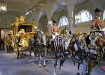 No, the horses and riders aren't real, but don't they look like they could be? The carriage weighs 4 tons and is drawn by 8 horses. There's a secret to how they get it out of this room.