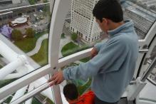 Aidan and Nathan gaze down from the London Eye.