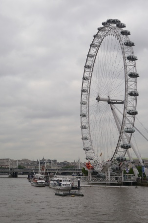 The London Eye on the banks of the Thames River.