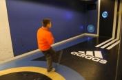 Aidan practicing his skills in the football museum.