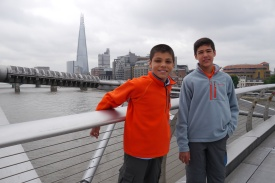 Aidan and Nathan posing on the Millennium Bridge crossing the Thames River.