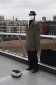Street performer on the Millennium Bridge.