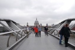 Boys on Millennium Bridge with St. Paul's Cathedral in the distance.