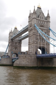 The towers of Tower Bridge over the Thames River.