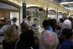 Upscale food hall inside Harrods. Pastery counter was seriously busy. We persevered.