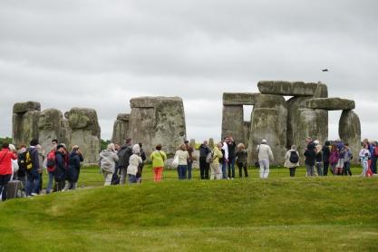 Crowds circling Stonehenge.