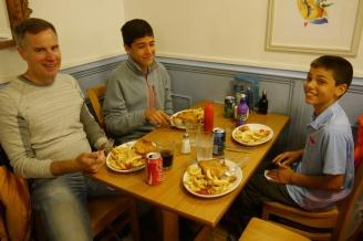 Steve, Nathan, and Aidan eating greasy fish 'n chips in Bath.