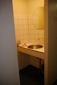 Bathroom sink area opposite the toliet.