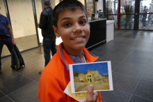 Aidan gets postcard reward for completing kids' program. It's a copy of his favorite Van Gogh painting, Yellow House.