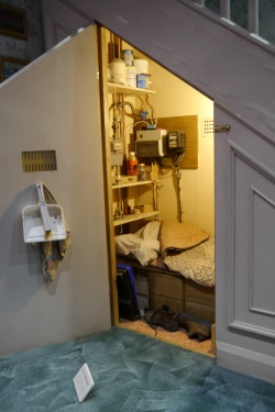 The room under the stairs, complete with Harry's eyeglasses.