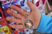 Aidan is buying a souvenir key chain in each country.