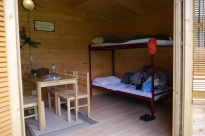 Notice how the bunk beds don't have safety bars.
