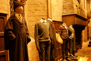 The Gryffindor uniform on the far left was Harry Potter's in the first movie.