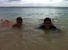 Aidan and Nathan swim in the Indian Ocean.