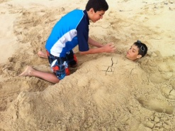 Nathan happily buried Aidan.