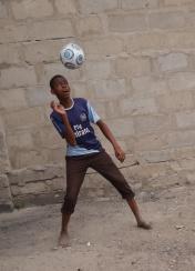 Boy heads the ball.