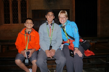 Aidan, Nathan, and Shellie sit at the student table in the Great Hall.