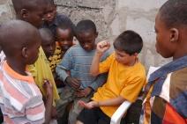 "Aidan tries to teach ""rock, paper, scissors"" to his new friend."
