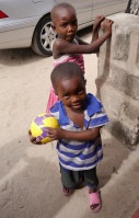 This young boy was so happy to receive a ball.