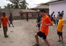 Nathan and Aidan playing soccer with boys