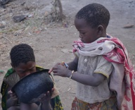 Hadzabe girls share a breakfast broth.