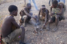 The bushmen put their fresh kills on the fire. They can make fire in seconds.