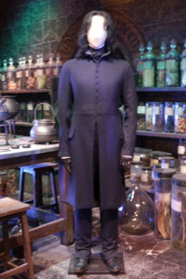 Snape stands in the potions classroom.