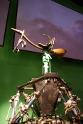Quidditch broom atop the mechanics that make it move in front of the CG screen.
