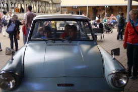 Four boys in the enchanted car that was attached by the Whooping Willow.