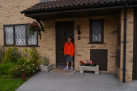 Aidan knocks on the door of number 4 Privet Drive.