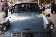 The whole gang in the enchanted muggle car.