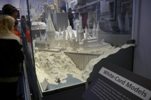 The set drawings are then made into white-card miniature models.