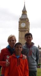 Shellie, Nathan, and Aidan with Big Ben and Parliament in the distance.
