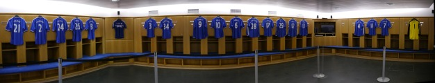 Home locker room, complete with team jerseys.
