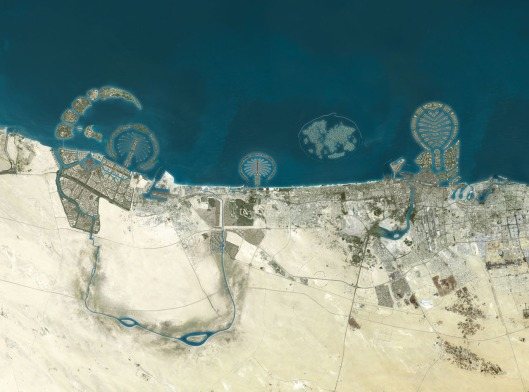 Satellite view of Dubai - from left to right, you see the Palm Jebel Ali, Palm Jumeirah, The World, and Palm Deira.