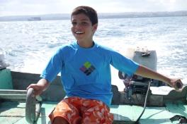 Aidan gleefully at the helm